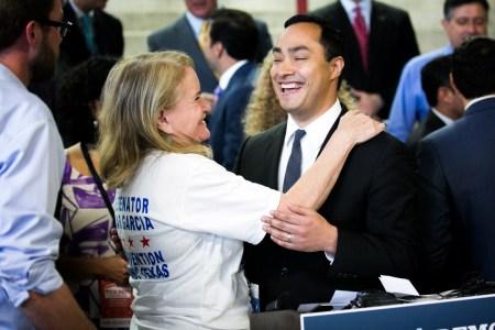 U.S. Rep. Joaquín Castro (D-Texas) shares a laugh with Senator Sylvia Garcia. Photo by Kathryn Boyd-Batstone.