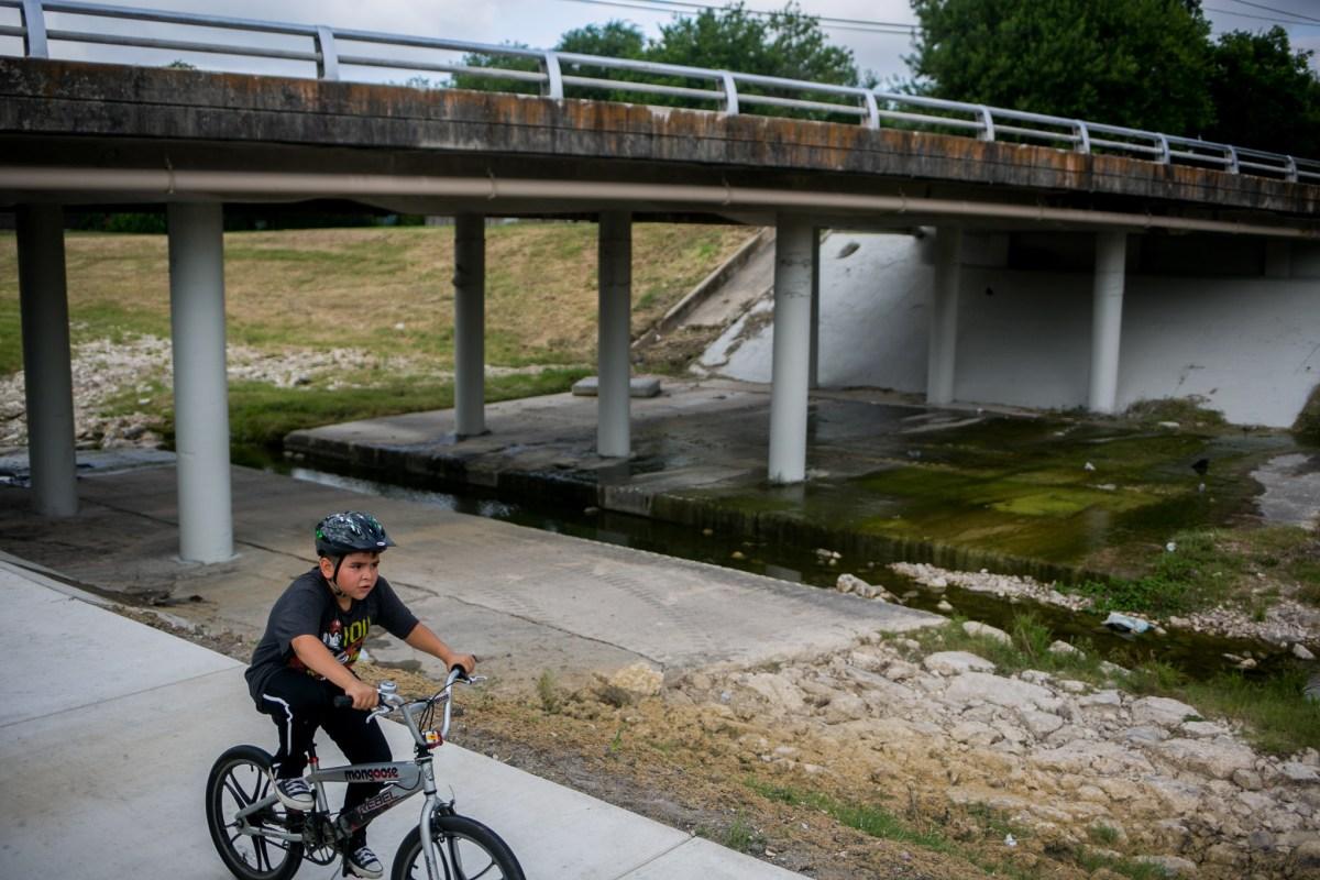 Sean, 10, celebrates his birthday with a ride along the Alazán Creek Linear at Woodlawn Lake Park. Photo by Kathryn Boyd-Batstone.