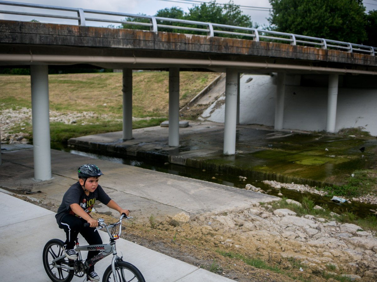 Sean, 10, celebrates his birthday with a ride along the Alazán Creek Linear at Woodlawn Lake Park. Photo by Kathryn Boyd-Batstone.
