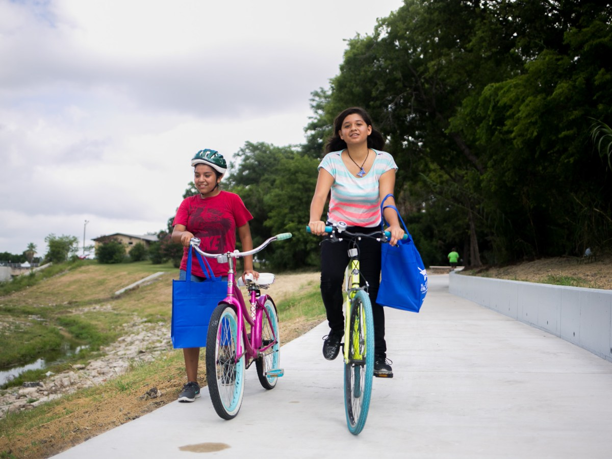 Faith Caerda, 14, bikes down the new Alazán Creek Linear Trail. Photo by Kathryn Boyd-Batstone.