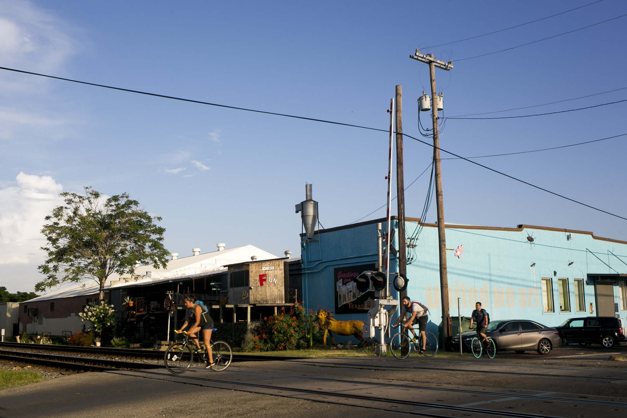 Bikers headed to the bike collective on South Flores Street.