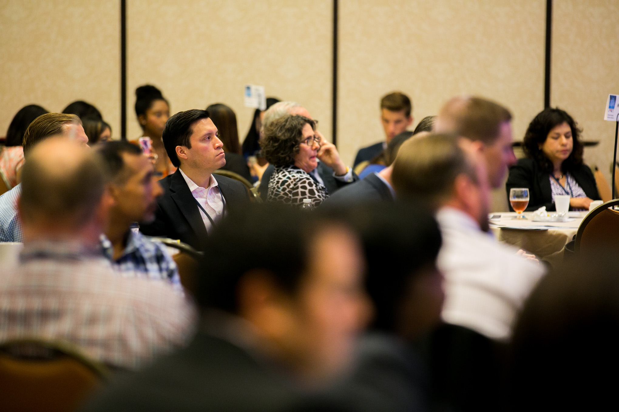 Attendees of the Cybersecurity Conference listen to talks about policy, plans and procedures developing to combat cyber crime. Photo by Kathryn Boyd-Batstone.