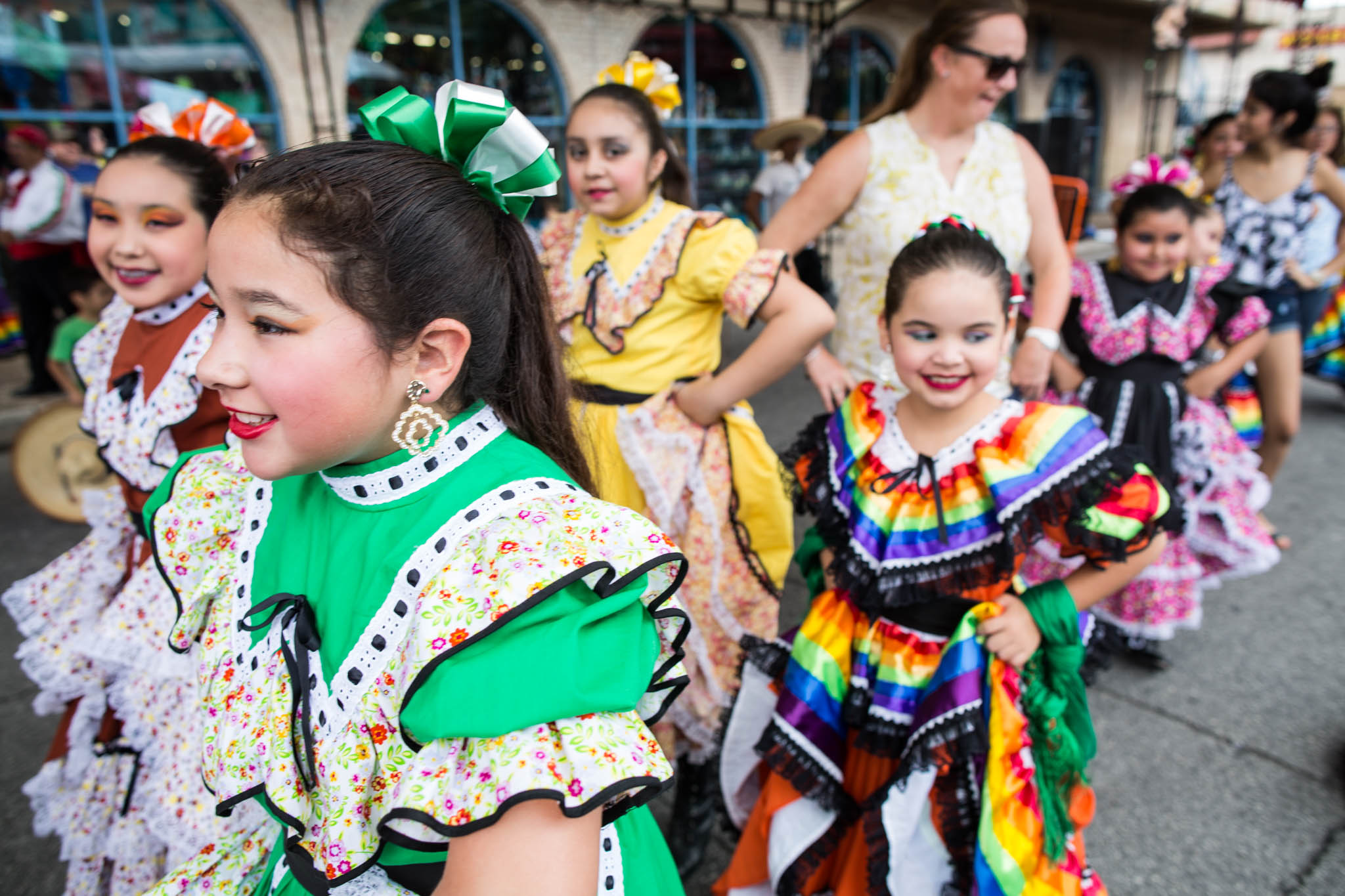 Young Ballet Folkorico dancers walk towards the stage. Photo by Michael Cirlos.