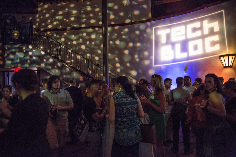 Attendees mix and mingle while pop music blares over speakers in the Pearl Stable. Photo by Michael Cirlos.