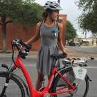 Urban commuting the easy, electric way. Elena Studier tries out an eProdigy electric bike. Photo by Robert Rivard.