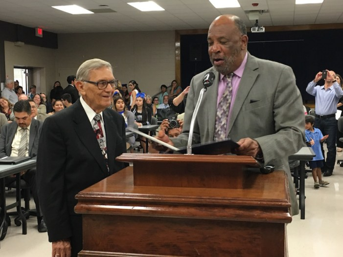Cristano Luna, 91, accepts honorary GED from SAISD Trustee James Howard. Photo by Bekah McNeel