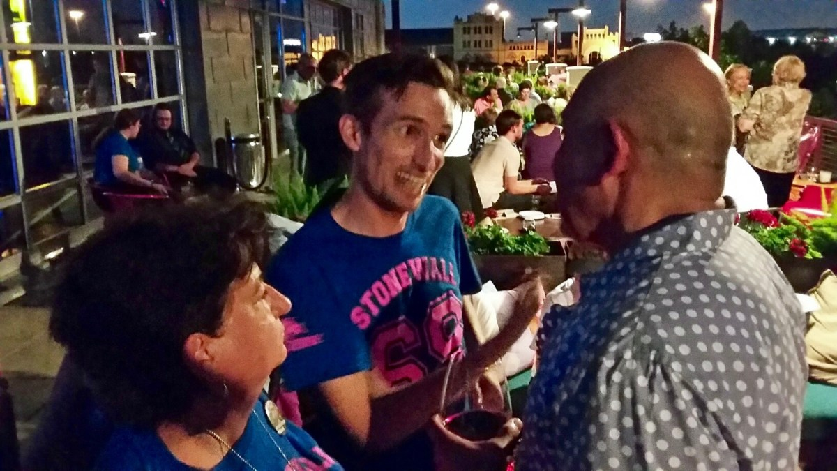 Eli Olivarez, Texas Stonewall Democratic Caucus president (right), listens to Nathan Schwarz at the TSDC party at Paramour on Thursday, June 16, 2016. At left is Schwarz's mother, Leslie Gower. Photo by Edmond Ortiz
