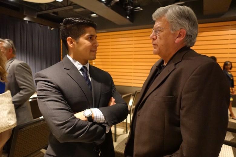 Councilman Rey Saldaña talks with SAWS Chairman Berto Guerra at the Pearl Studio. Photo by Robert Rivard.