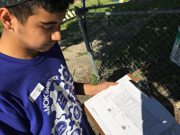 Ethan Ladesma shows his plans for landscaping and exterior work during H-E-B's Tournament of Champions. Photo by Bekah McNeel.