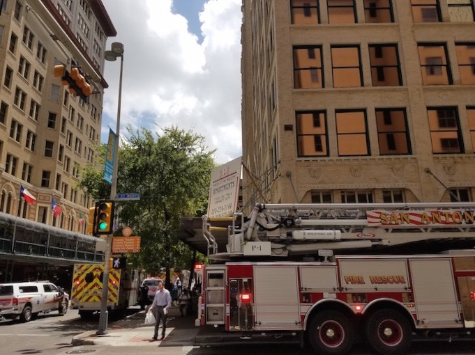 Emergency vehicles respond to a sprinkler leak at the Brady Tower and Empire Theatre Monday. Photo by Iris Dimmick.