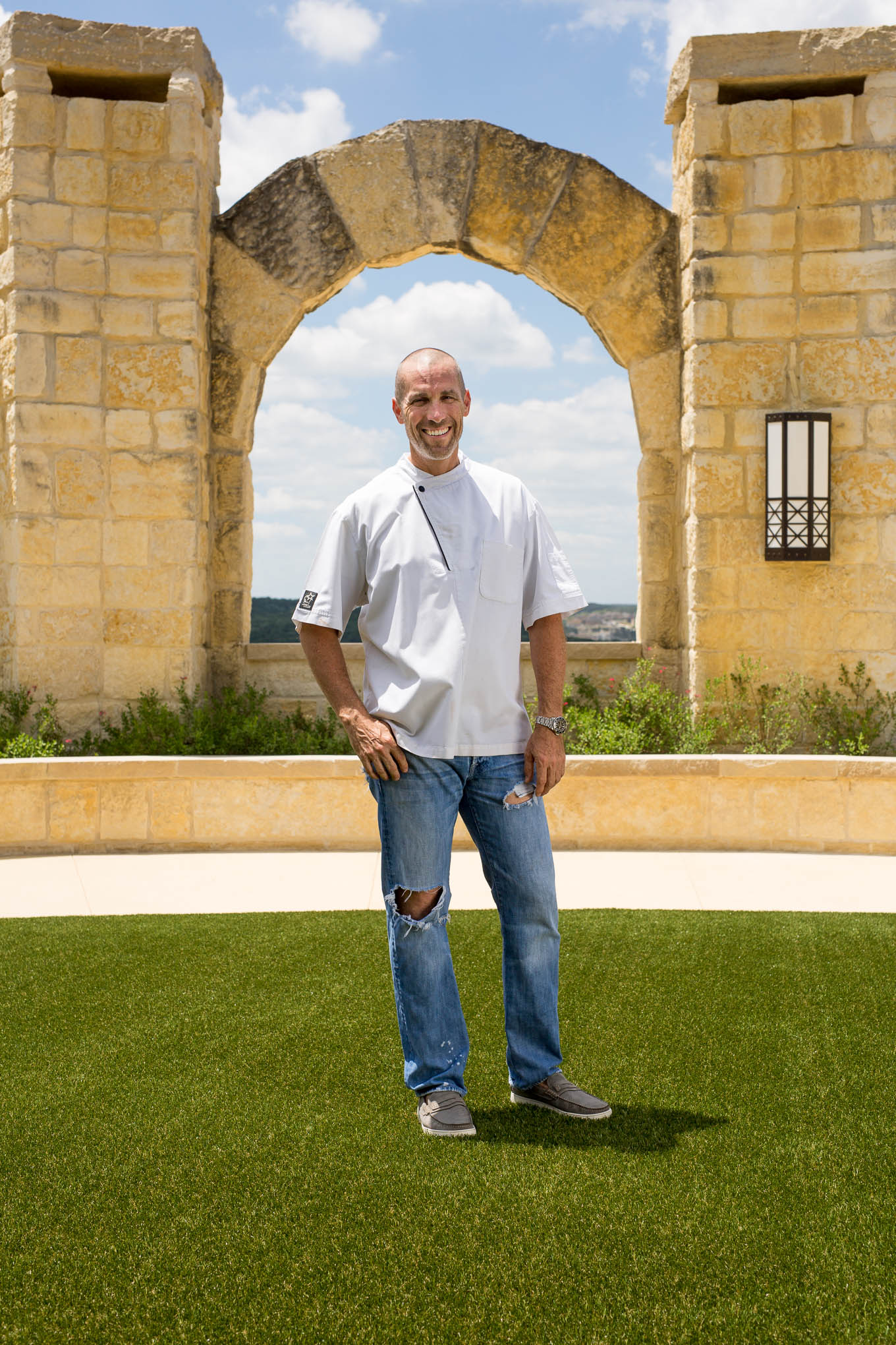 Andrew Weissman stands for a photograph in front of the arches at La Cantera Resort & Spa. Photo by Scott Ball.