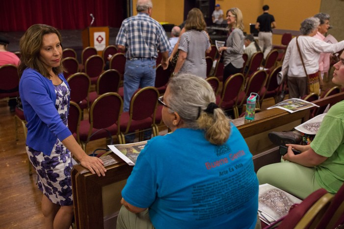 Councilwoman Shirley Gonzales (D5) speaks with community members before the public meeting. Photo by Scott Ball.