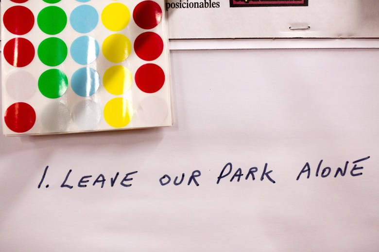 """Large sheets of white paper were stationed next to large boards of proposed changes for Brackenridge Park encouraging community members to write their thoughts down this page reads """"Leave Our Park Alone"""".(1/2). Photo by Scott Ball."""