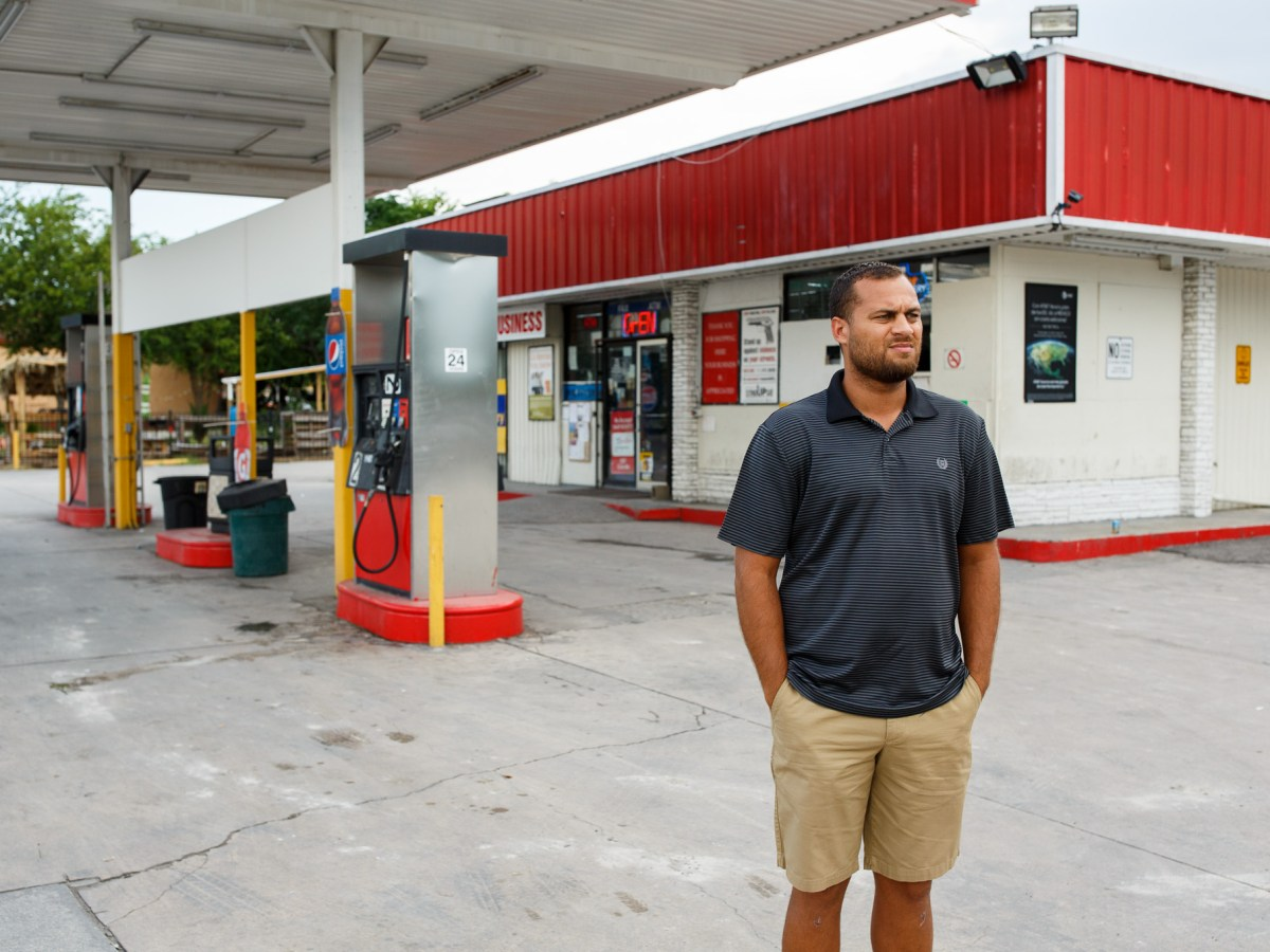 Dignowity Hill Neighborhood Association President Brian Dillard stands in front of one of the hottest crime spots in San Antonio, Handy Stop Convenience Store on 627 North New Braunfels Avenue. Photo by Scott Ball.