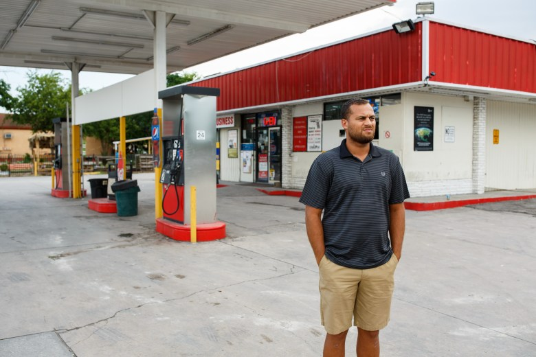 Dignowity Hill Neighborhood Association President Brian Dillard stands in front of the Handy Stop Convenience Store on 627 N. New Braunfels Ave. Photo by Scott Ball.