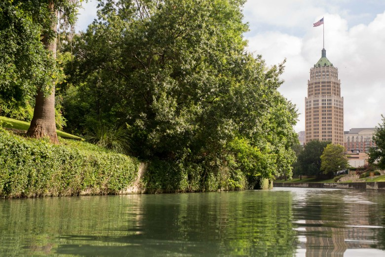 The Tower Life Building casts a shadow over the San Antonio River. Photo by Scott Ball.