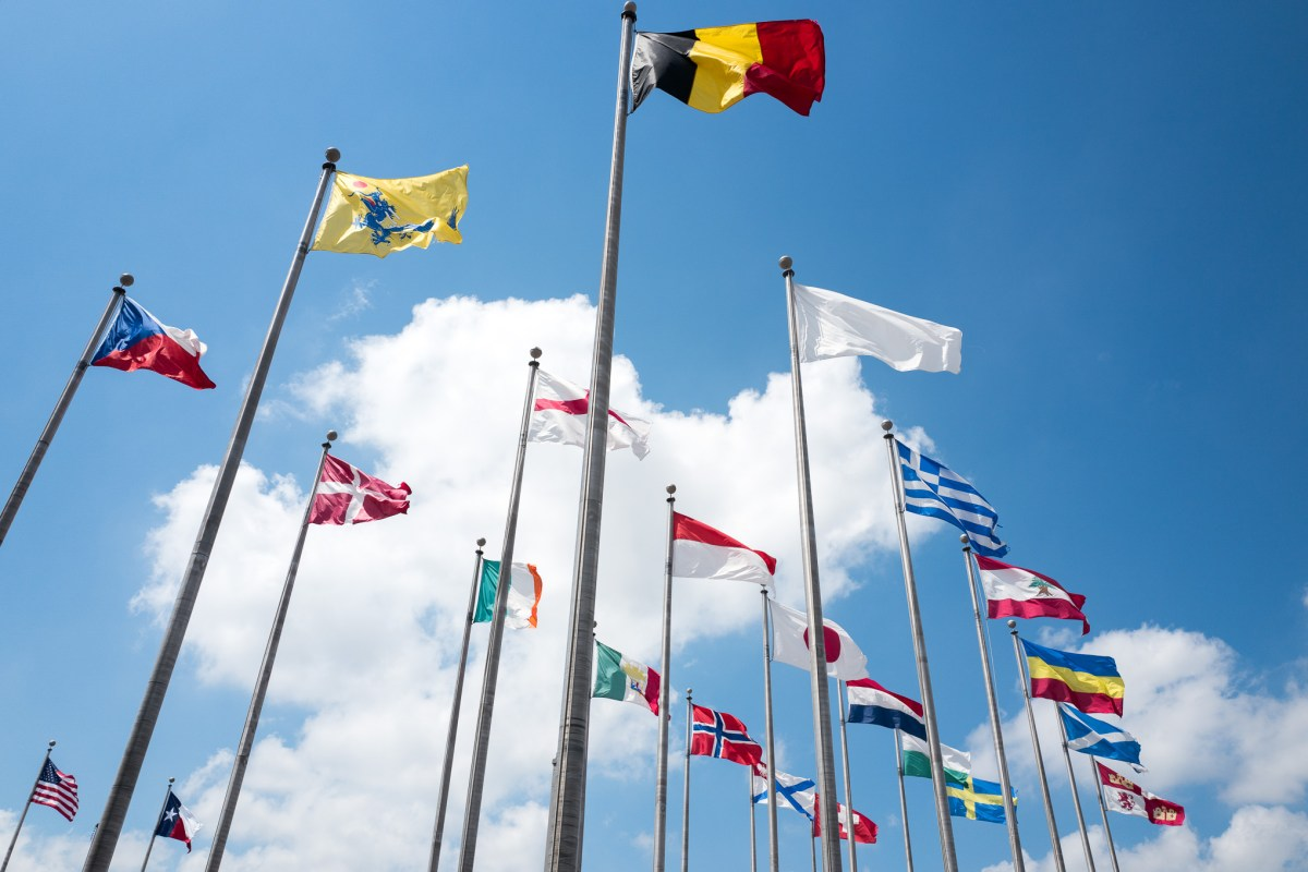 Flags from around the world are prominently displayed outside the UTSA Institute of Texan Cultures. Photo by Scott Ball.