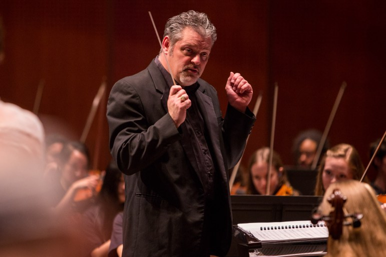 YOSA Music Director Troy Peters conducts the orchestra during Abbey Road Live. Photo by Scott Ball.
