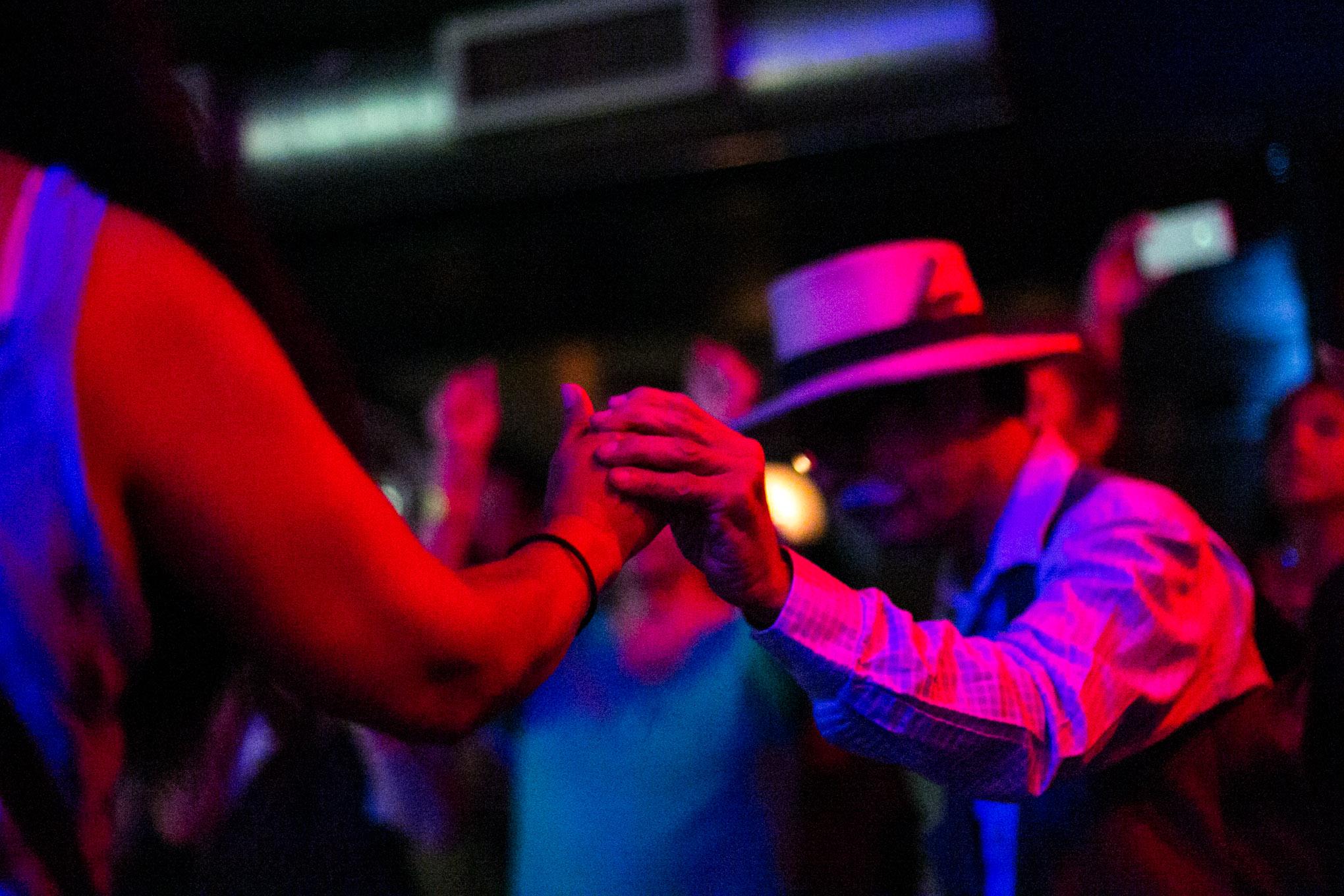 Couples dance to the conjunto music of Acordeón Eva Ybarra. Photo by Kathryn Boyd-Batstone.
