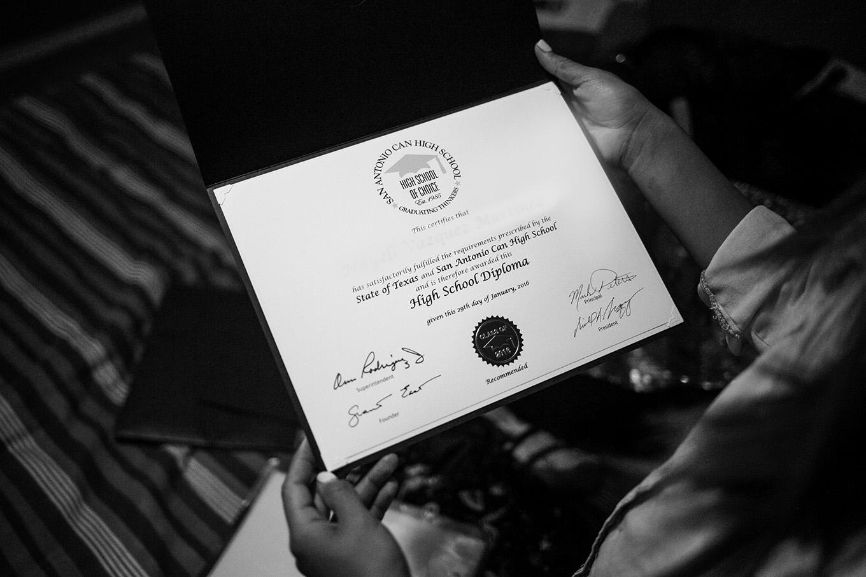 Araceli shows her San Antonio CAN High School diploma. Photo by Kathryn Boyd-Batstone.