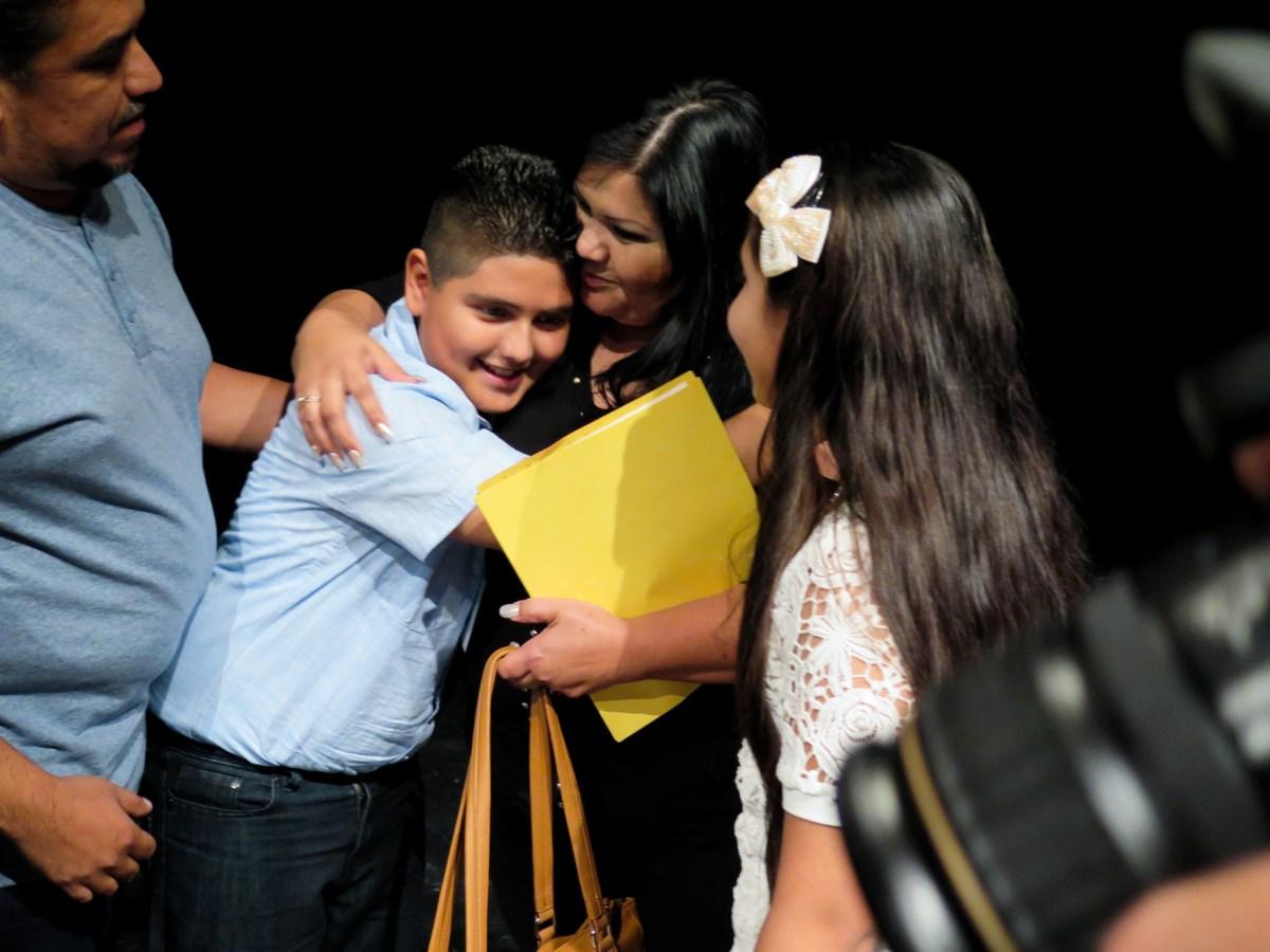 Rocío Hidrogo de Reynoso hugs her son Jybr as his father Liborio and sister Keytt look on. Photo by Rocio Guenther.