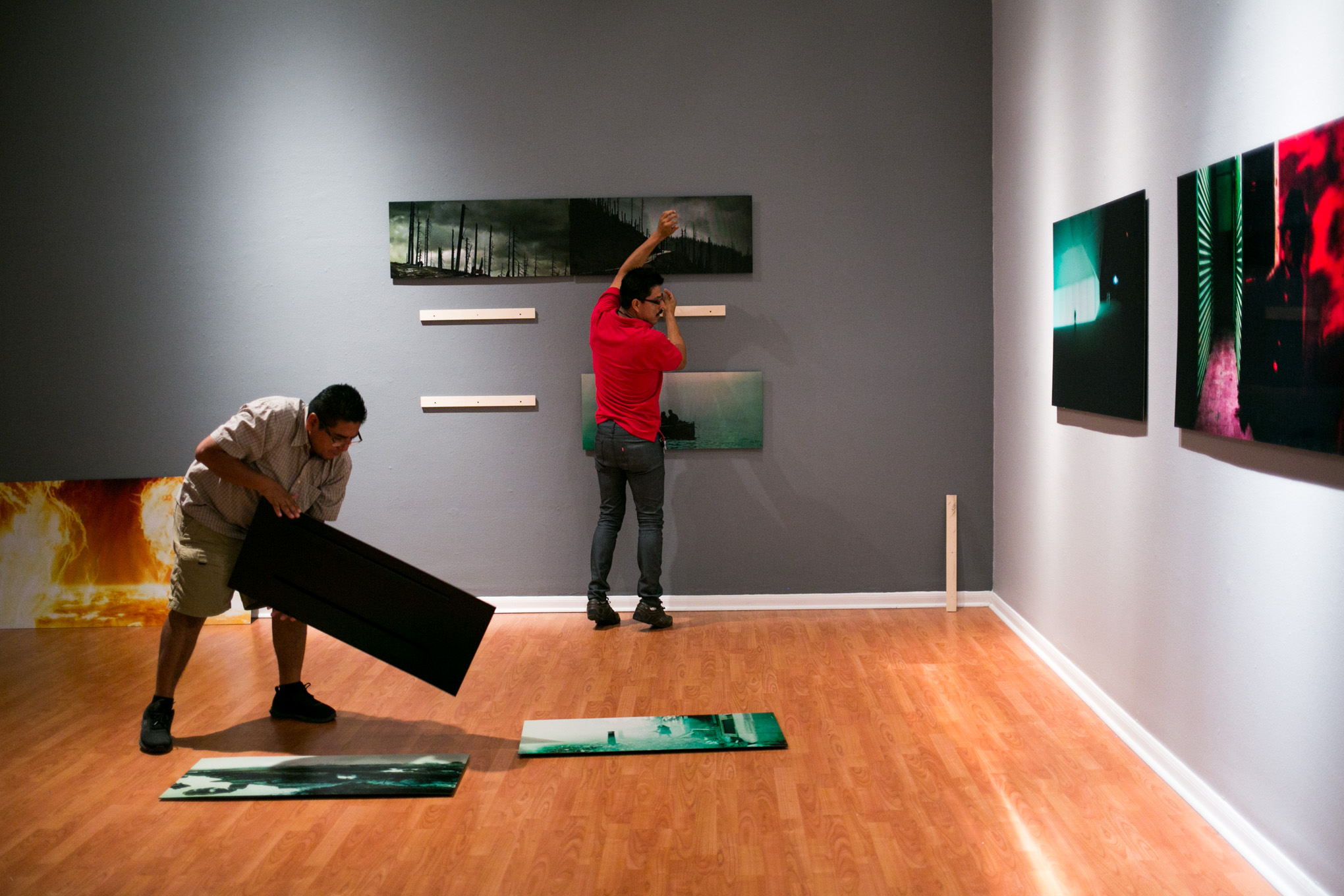 """Instituto Cultural de México staff begin setup for the """"Mundos Posibles   Possible Worlds"""" exhibit. Photo by Kathryn Boyd-Batstone."""