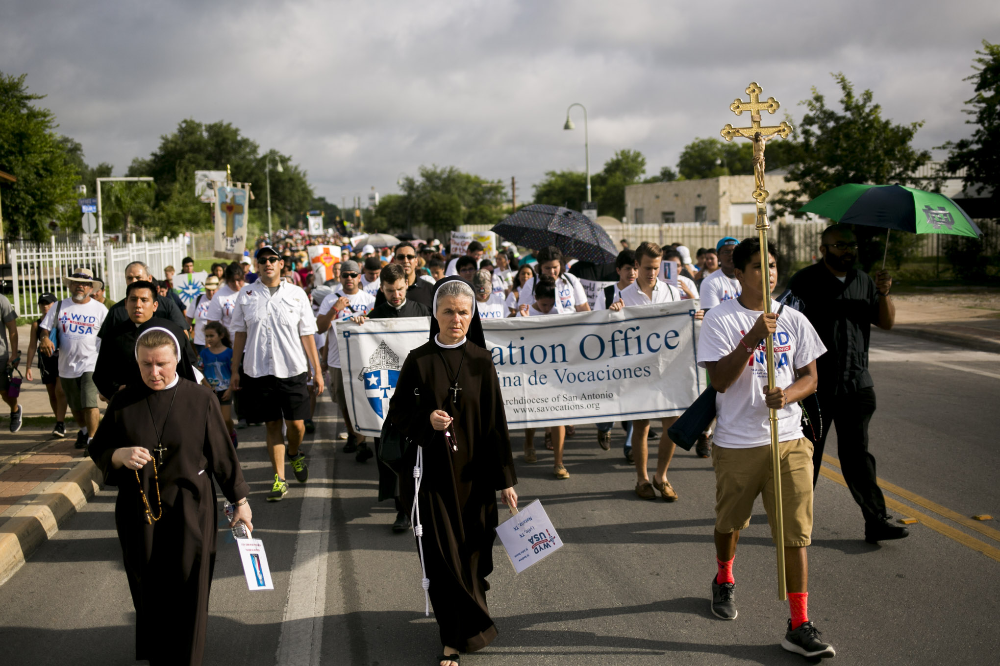 Hundreds walk in the Pilgrimage from Mission Concepción to Mission San José for World Youth Day San Antonio 2016. Photo by Kathryn Boyd-Batstone.