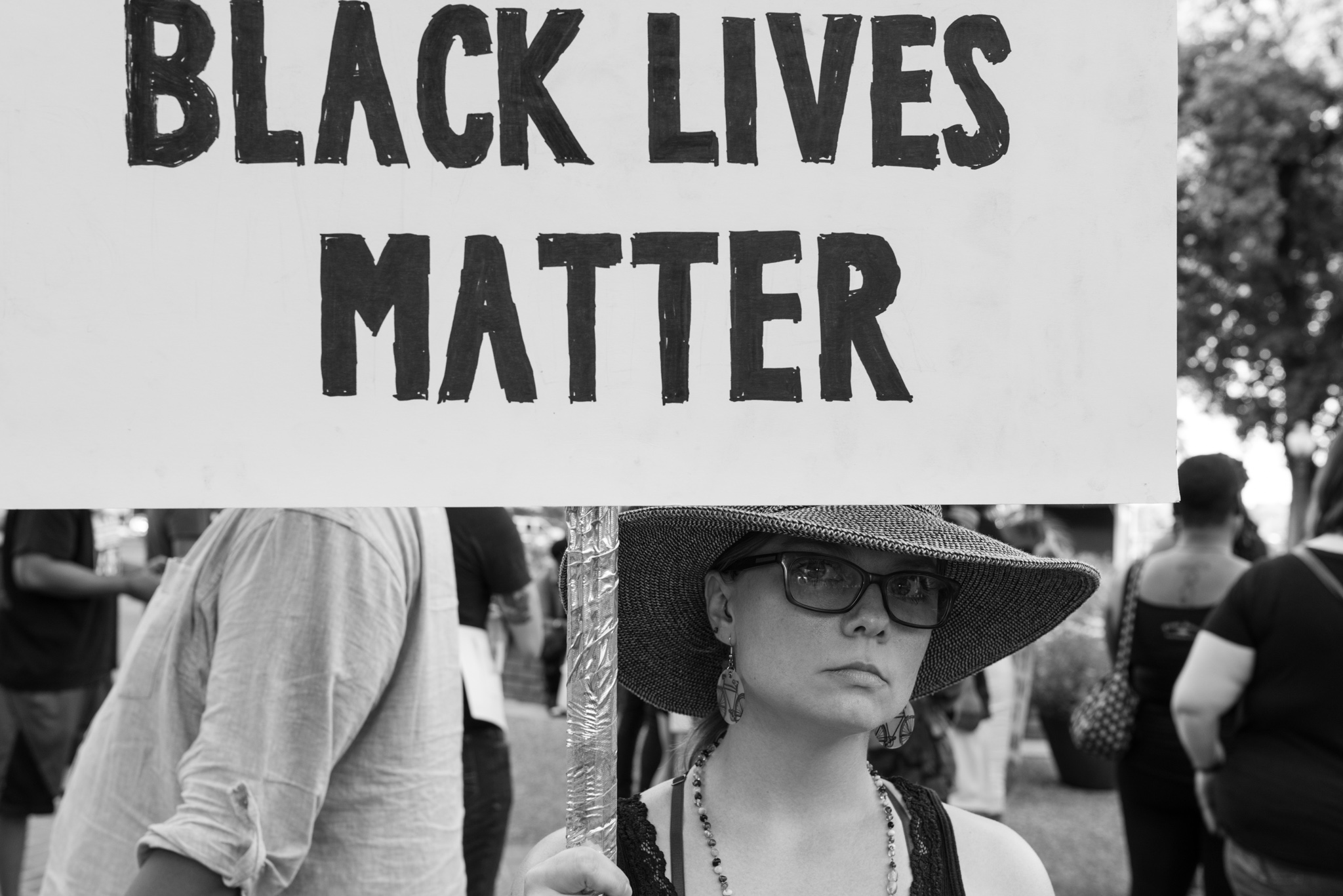 Elizabeth Larder, 34, holds a sign reading 'Black Lives Matter' during the rally. Photo by Anthony Francis.
