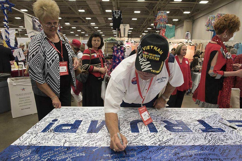 Vietnam veteran Jim Faulkner of Calhoun County signs a Trump for President banner at the Republican Party of Texas event in Dallas May 13, 2016. Photo by The Texas Tribune/Bob Daemmrich.