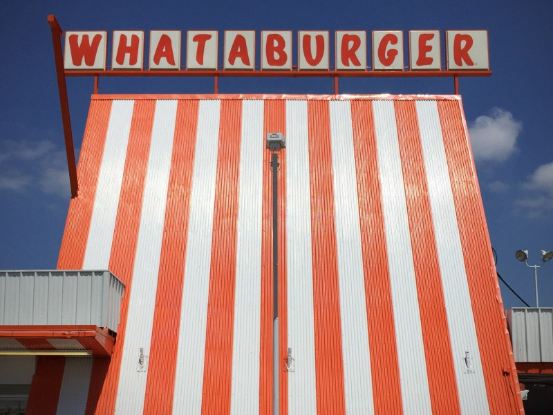 The iconic international orange and white stripes of an original Whataburger A-frame in Mesquite, Texas. Photo by Brantley Hightower.