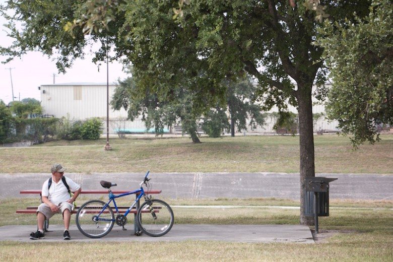 A local man rests on a park bench at Cassiano Park before taking off on the newly built bike trail. Photo by Amanda Lozano.