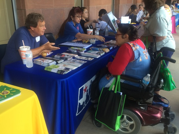 Bryan Baldwin (left) speaks with Irma Burkhart about the resources the Texas Dept. of Assistive & Rehabilitation Services offers. Photo by Camille Garcia.