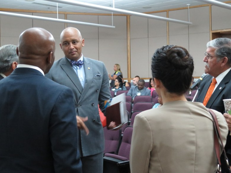 Councilman Alan Warrick (D2) speaks to James Cole Jr., general counsel, delegated the duties of deputy secretary of education. Photo by Rocío Guenther.