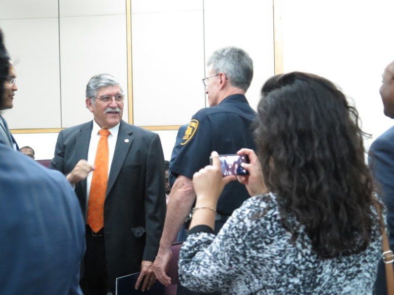 UTSA President Ricardo Romo greets San Antonio Police Chief William McManus and other attendees. Photo by Rocío Guenther.