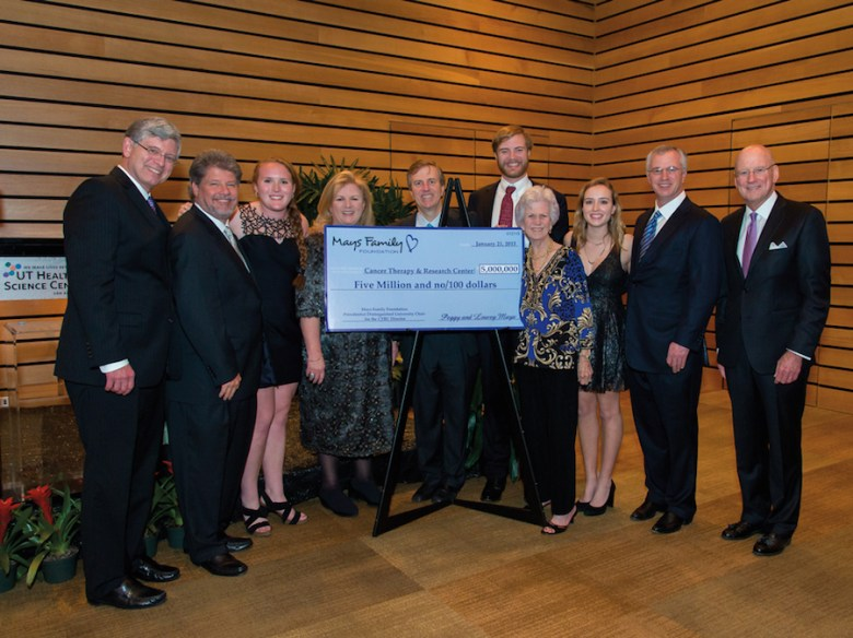 (from left) Dr. Ian M. Thompson Jr., Bill Johnson, Paige Johnson, Kathy Mays Johnson, Mark Mays, Ryan Mays, Peggy Mays, Margot Mays, Randall Mays and Dr. William L. Henrich. Courtesy photo.