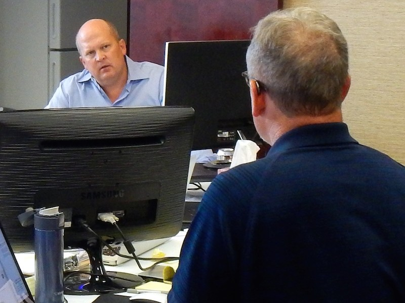 "Mikal Watts (left) and Mike McCrum strategize in the ""war room"" prior to their trial in GUlfport, Miss. Photo by Desi Canela."