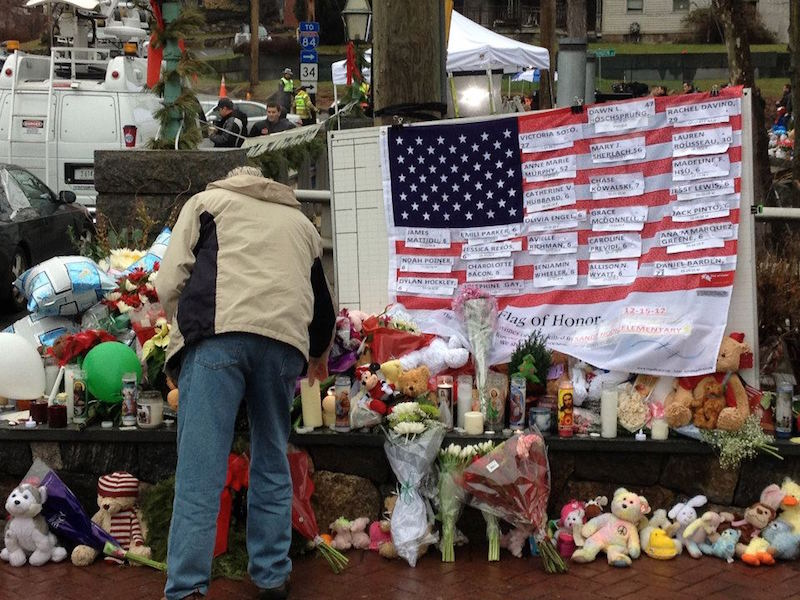 The downtown square in Newtown, Conn. is covered in flowers, pictures, and pieces of art as a tribute to the lives taken at Sandy Hook Elementary School. Photo by Laura Beth Wallace.