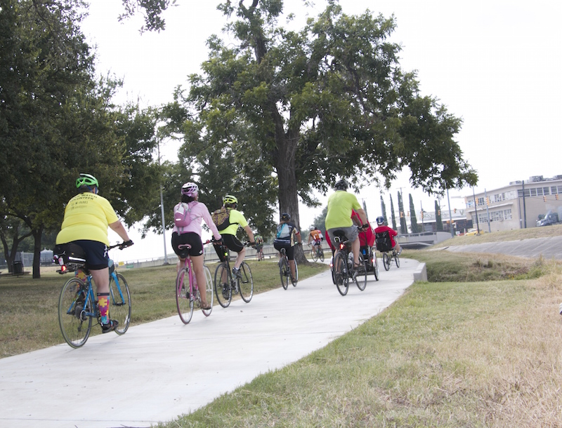 A group of bikers kick off the official opening of the Apache Creek Trail with a community ride. Photo by Amanda Lozano.