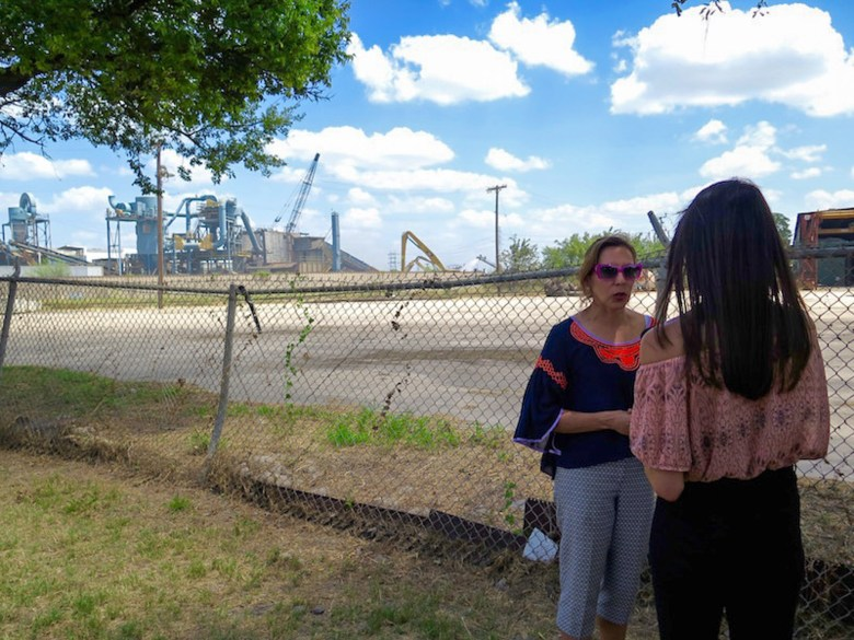 Councilwoman Shirley Gonzales (D5) speaks to a member of the media at the site of a fire at CMC Recycling on Probandt Street. Photo by Sarah Talaat.