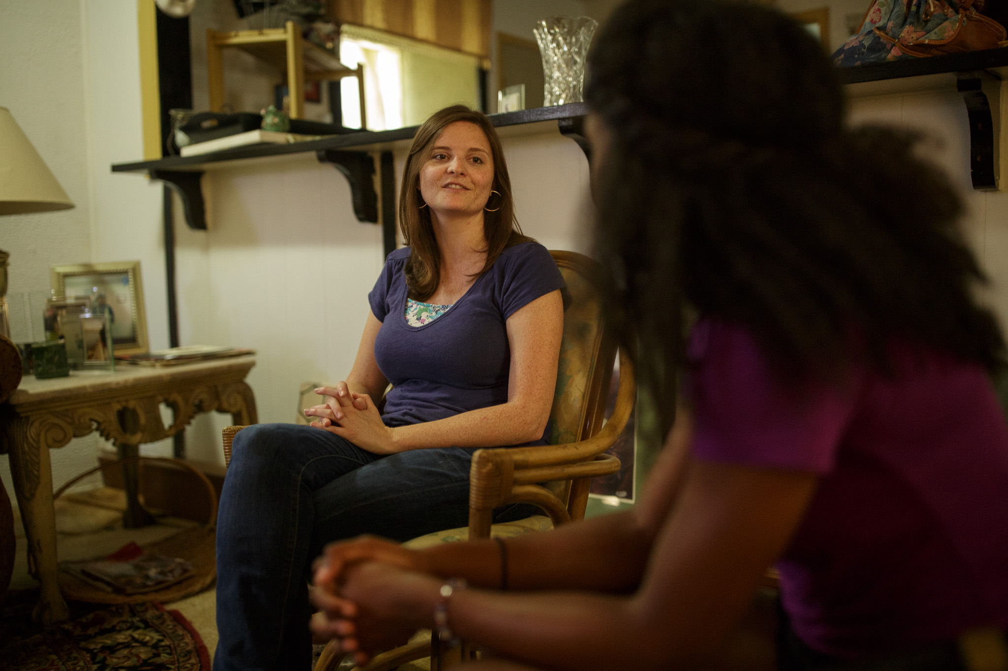 Michelle Roberts speaks with Brooke about making plans for one on one activities soon. Photo by Scott Ball.