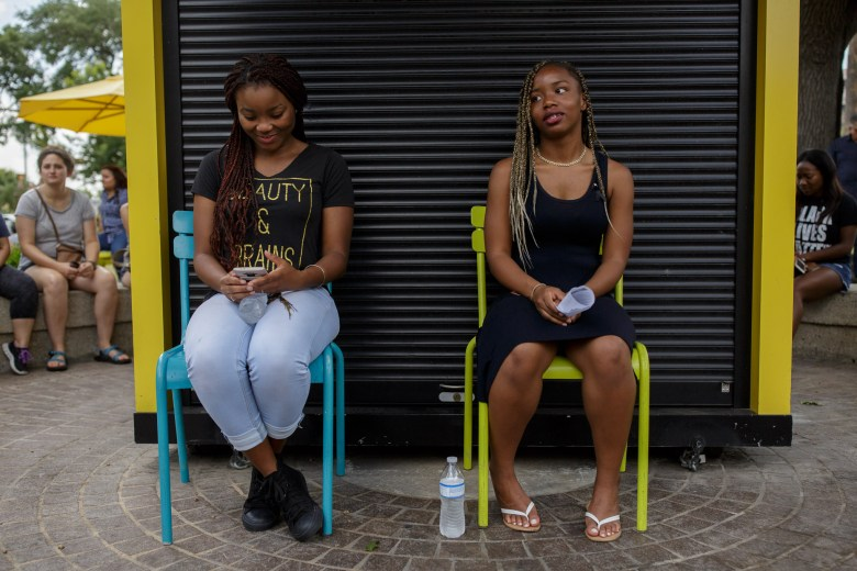 UTSA students Khalani Valentine (left) and Desiré Walker made the trip from the city's Northside for this protest. Photo by Scott Ball.