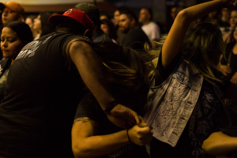 Attendees create a mosh pit during one of the fast paced Piñata Protest songs. Photo by Scott Ball.