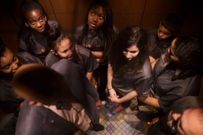 Teens in the Eastside Dreamers Academy occupy an elevator at City Hall along with Winslow Swart as it travels to the upstairs offices. Photo by Scott Ball.