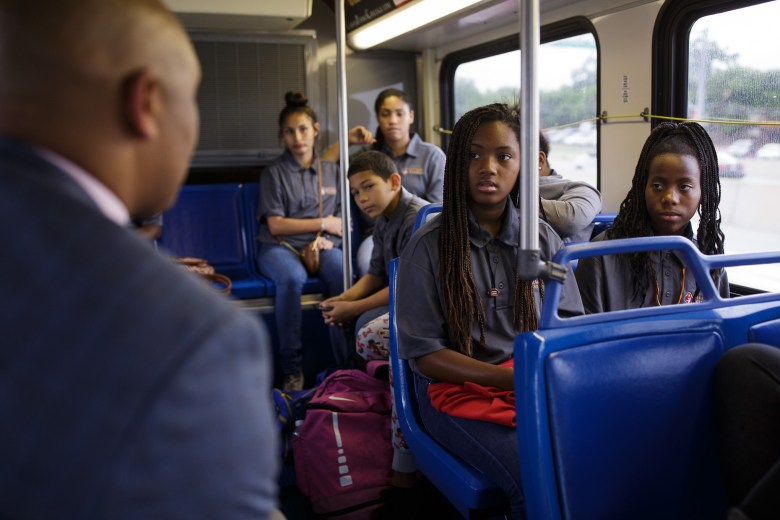 Councilman Alan Warrick (D2) talks with Eastside Dreamers about their future careers on the way to the Toyota Motor Manufacturing facility on the city's Southside. Photo by Scott Ball.
