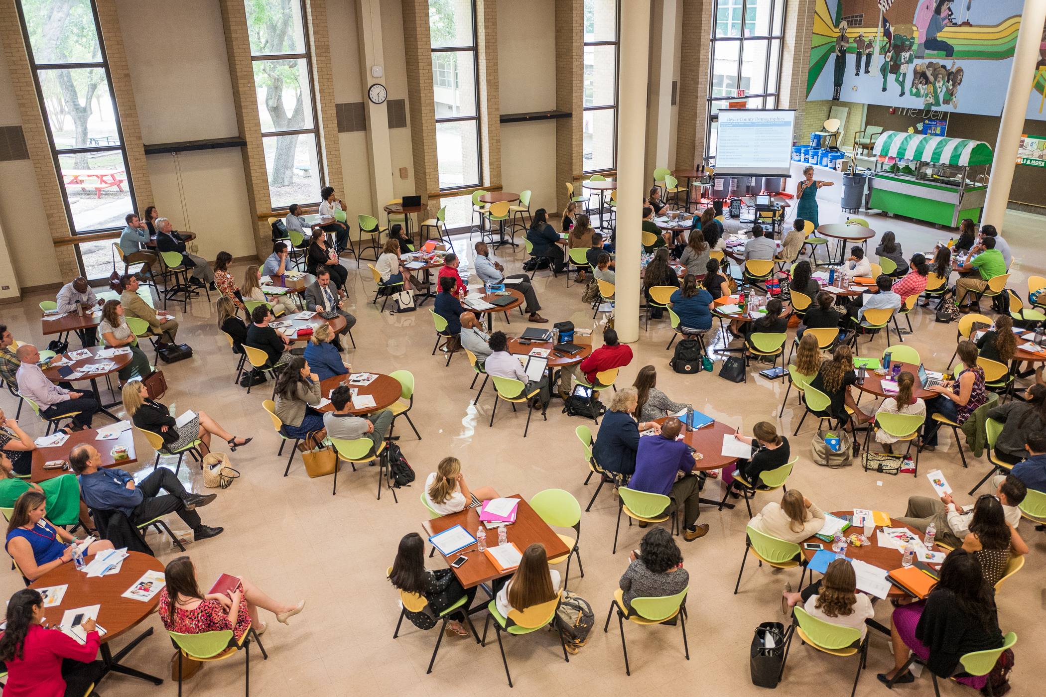 The cafeteria at Sam Houston High School is filled with educators during A History of Public Education in San Antonio hosted by San Antonio Teach for America. Photo by Scott Ball.