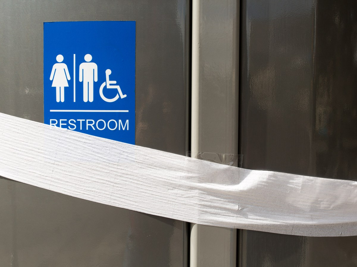 Toilet paper surrounds the restroom before the official paper cutting marking it's opening. Photo by Scott Ball.