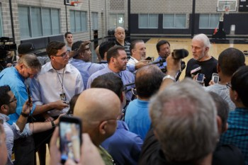 San Antonio Spurs Headcoach Gregg Popovich discusses the legacy of Tim Duncan following his announcement to retire after 19 seasons in the NBA, all with the Spurs. Photo by Scott Ball.