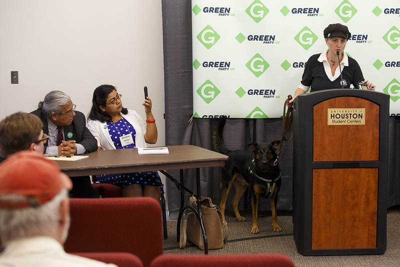 Green Party Secretary of State Katija Gruene, right, speaks about Texas Green Party Railroad Commissioner candidate Martina Salinas, center, and Texas Supreme Court candidate Rodolfo Rivera Munoz, left, at a press conference during the Green Party Presidential Convention in Houston on Friday, August 5, 2016. Photo by Michael Stravato for the Texas Tribune.