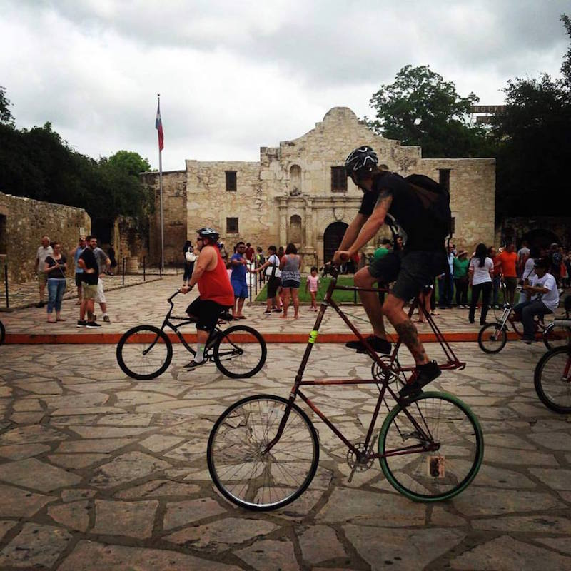 A cyclist on a specialty bike in front of the Alamo. Photo courtesy of Siclovia.