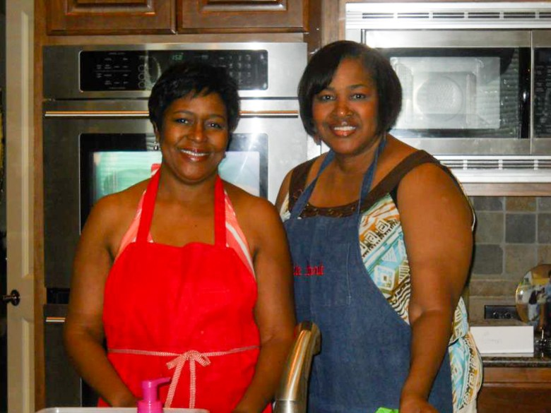 Sisters Marva B. Crisp and B. Arrie Porter (right) smile in the kitchen. Photo courtesy of Arrie B. Porter.